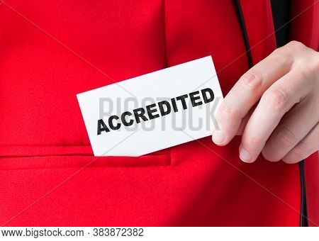 Message On The Card Accredited, In Hands Of Businessman.