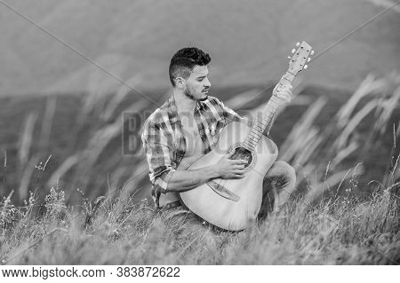 Inspired Musician Play Rock Ballad. Compose Melody. Inspiring Environment. Man With Guitar On Top Of