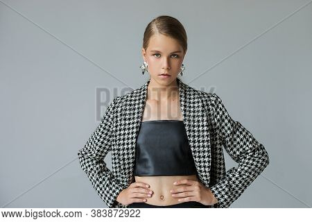 Young Beautiful Brown-haired Girl In Fashionable Clothes Spring Autumn Season Looks At The Camera. C