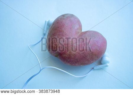 Potato Heart And White Headphones For The Phone.potatoes And Headphones On A White Background
