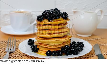 Pancakes. Sweet Honey Pouring Over Pancakes With Berry Fruit. Tasty Breakfast Food. Stack Of America
