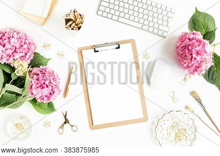 Stylized Womens Desk. Workspace With Clipboard, Computer, Bouquet Hydrangea, Accessories On White Ba