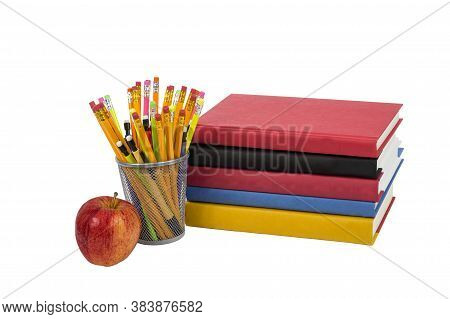 Colorful Horizontal Photo Of A Stack Of Books With An Apple And Colorful Pencils. Isolated On A Whit