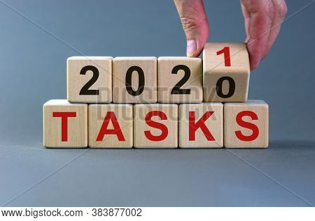 Business Concept Of Planning 2021. Male Hand Flips Wooden Cube And Change The Inscription 'tasks 202