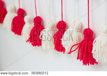 Brushes From Yarn Of Red And White Color On A White Background. Diy Yarn Brushes. Garland. Garland O