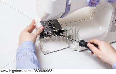 Sewing Machine Repair. Screwdriver. White Sewing Machine. Sewing Content. Repair Of Household Applia