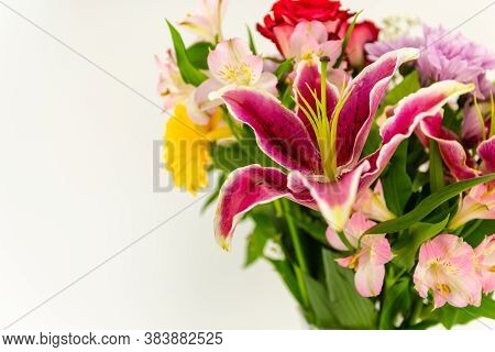 Beautiful Purple Lily Flower Over A Bouquet Of Colorful Flowers With Blank Copy Space For Your Text