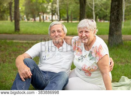 Senior Woman Hugging Her Partner And Laughing Together. Senior Couple Having Fun And Embracing. Cauc
