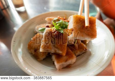 Taiwanese snack of turnip cake on a table in the restaurant