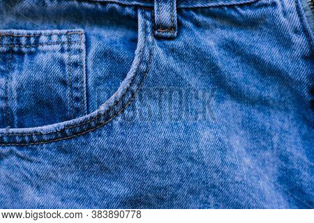 Details Of Denim Trousers. Pockets And Seams On Denim.old Blue Denim.the Texture Of The Fibers Of Th