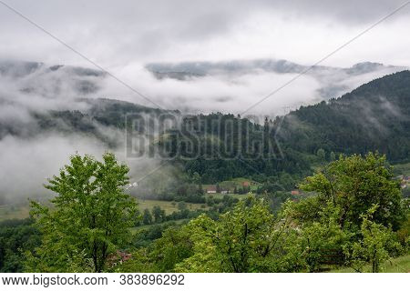 Green Valley Nature Landscape. Mountain Layers Landscape. Rain And Fog In Mountain Forest Landscape.