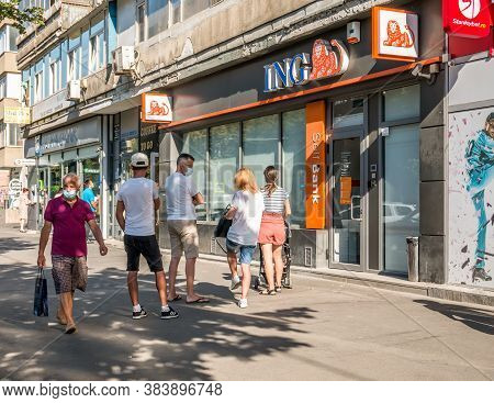 Bucuresti/romania - 08.18.2020: People Waiting In Line In Front Of A Ing Bank Branch Respecting The