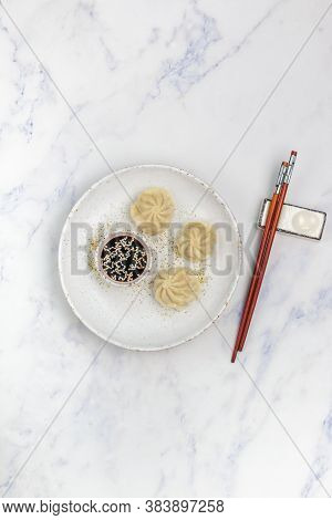 Dumplings With Meat Or Seafood (pork, Beef, Fish, Shrimp) With Soy Sauce And Sesame Seeds. Eastern A