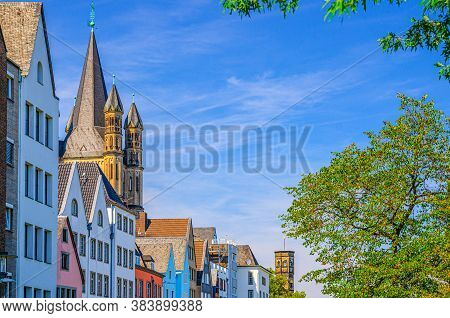 Row Of Colorful Facade Buildings, Great Saint Martin Roman Catholic Church Tower With Spire And Gree