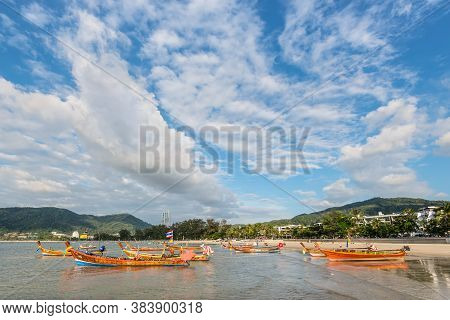 Phuket, Thailand - November 29, 2019: Traditional Longtail Boats On The Shore Of Patong Beach In Phu