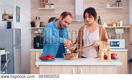 Married Couple Preparing Salad With Fresh Vegetables In Kitchen. Cooking Preparing Healthy Organic F