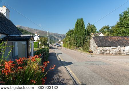 Glencoe, Scotland, Uk - August 15, 2020:  View Of A Main Street And Houses In The Village Of Glencoe