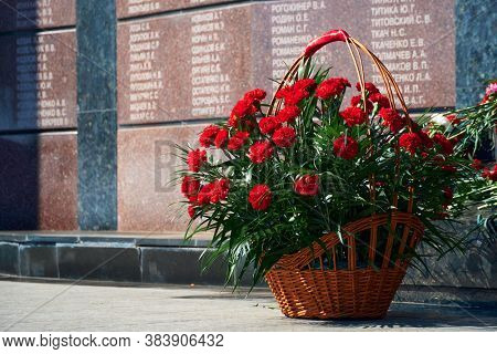 Tiraspol, Transnistria - September 2, 2020: date 30th anniversary of independence, flowers on the memorial to fallen soldiers, Russian text with different names