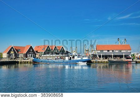 Oudeschild, Texel / Netherlands - August 2019: View On Harbor With Blue Ship 'rival' Offering Sport