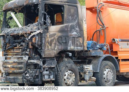 Burnt Truck On The Side Of The Road. Fully Burnt Truck Cab.