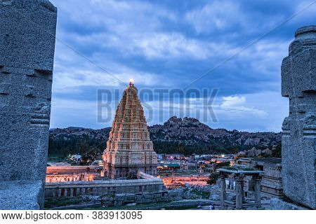Shree Virupaksha Temple With Bright Dramatic Sky Background At Evening Shot Is Taken At Hampi Karnat