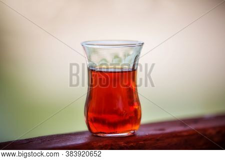 A Glass Of Turkish Tea Close-up. Traditional Turkish Drink. Strongly Brewed Tea In A Transparent Cup