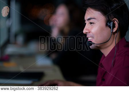 Thai Asian Man Customer Services Care Operators Working Night Shift In Call Center For Helping Assis