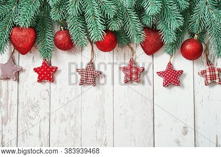Christmas Tree Red Toys Background. Pine Branches On White Wooden Background. Flat Lay. Copy Space.