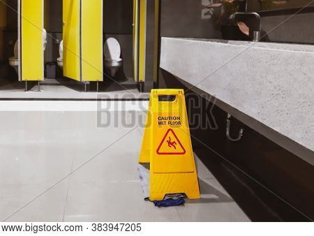 Sign Yellow Slippery Warning Floor Wet, Caution For Toilet Room Cleaning Progress. Safety Sign With