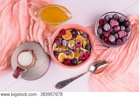 Breakfast Of Small Pancakes With Berries And Honey And Milk On White Background. Pancake Porridge. F