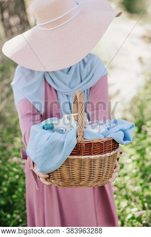 The Girl Is Holding A Basket With Hijama Cans. Bloodletting. Muslim Hijam. The Doctor Who Does The B