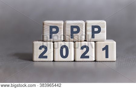 Ppp Text On Wooden Cubes On A Monochrome Background