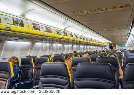 Malaga / Spain - August 15th, 2020: Half Empty Airplane, Passengers With Face Masks, Ryanair