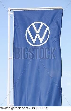 Belleville, France - August 23, 2020: New Volkswagen Logo On A Flag. Volkswagen Is A German Car Manu
