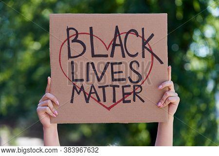 Kiev, Ukraine - July 31: Black Lives Matter Poster With Heart In Human Hands. Stop Racism Concept. B