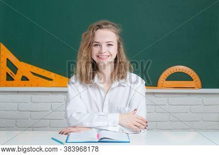 Happy Teenage Girl Smiling In High School. Teenager Girl With Notebooks In Highschool During Break.