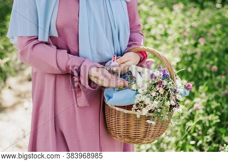The Woman Is Holding A Basket With Hijama Cans. Bloodletting. Muslim Hijam. The Doctor Who Does The