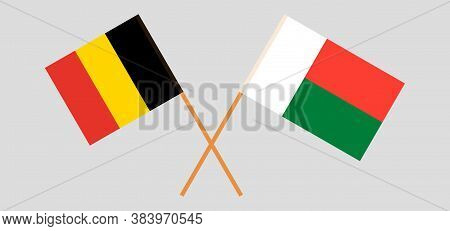 Crossed Flags Of Madagascar And Belgium. Official Colors. Correct Proportion. Vector Illustration