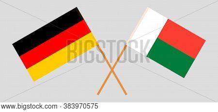 Crossed Flags Of Madagascar And Germany. Official Colors. Correct Proportion. Vector Illustration