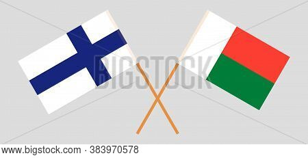 Crossed Flags Of Madagascar And Finland. Official Colors. Correct Proportion. Vector Illustration