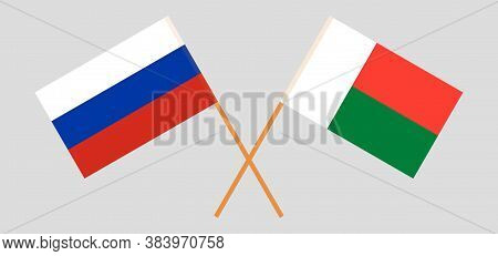 Crossed Flags Of Madagascar And Russia. Official Colors. Correct Proportion. Vector Illustration