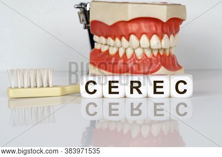 Medical, Dental Concept. The Text Is Written On The Cubes - Cerec. In The Background, A Model Of The