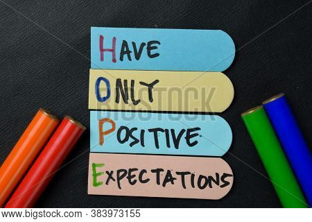 Hope - Have Only Positive Expectations Write On Sticky Notes Isolated On Office Desk.
