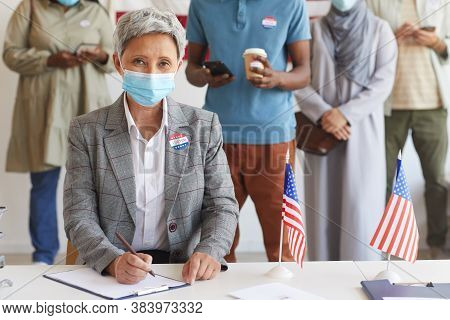 Multi-ethnic Group Of People Standing In Row And Wearing Masks At Polling Station On Election Day, F