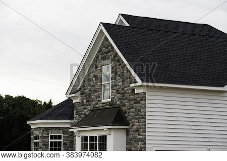 Edge Of Roof Shingles On Top Of The House Dark Asphalt Tiles On The Roof Background