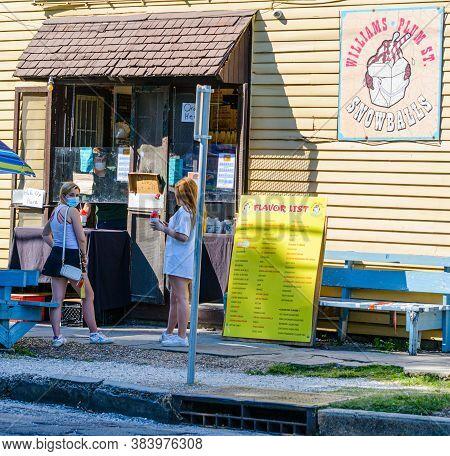 New Orleans, Louisiana/usa - 06/17/2020: Two Girls Ordering  Snowballs At Williams Plum Street Snowb