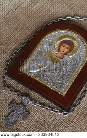 Silver Pectoral Cross With A Chain Around The Icon Of The Archangel Michael On Sackcloth. Christian