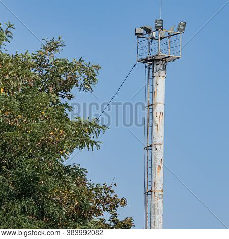 The Observation Floodlight Platform Is Installed On A Pole. A Ladder For Ascent And Descent, A Light