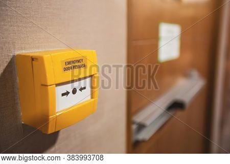 Close-up Emergency Door Release Switch At The Fire Exit Door In The Building.