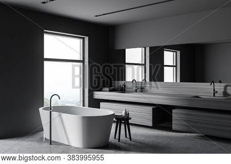 Corner Of Modern Bathroom With Gray And Wooden Walls, Concrete Floor, Comfortable Bathtub And Double